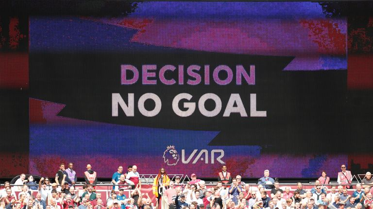 A scoreboard displays the VAR decision to disallow a goal during a match