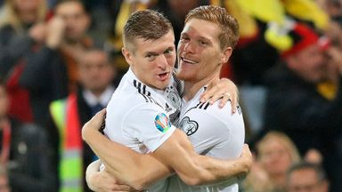 Germany's defender Marcel Halstenberg (R) celebrates with Germany's midfielder Toni Kroos (L) after scoring the opening goal during the the Euro 2020 football qualification match between Northern Ireland and Germany at Windsor Park in Belfast on Sept