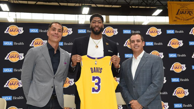 Anthony Davis, flanked by Lakers general manager Rob Pelinka and coach Frank Vogel, is introduced to the Los Angeles media