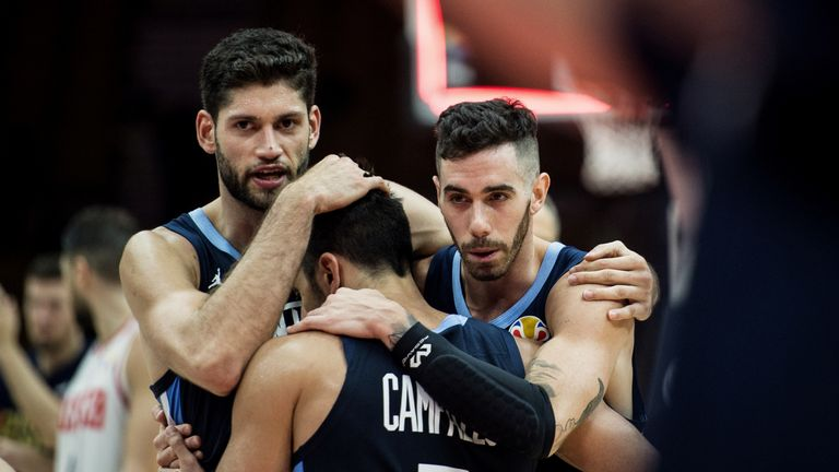 Facundo Campazzo is embraced by his teammates during the win over Russia