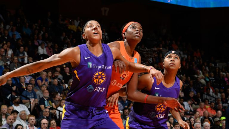 Candace Parker and Jonquel Jones battle for a rebound during Los Angeles and Connecticut's Game 1 clash