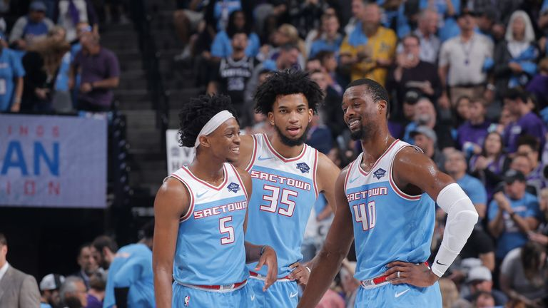 De'Aaron Fox, Marvin Bagley and Harrison Barnes share a word during a Kings game
