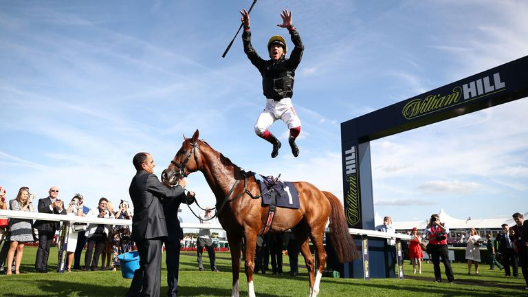 Frankie Dettori dismounts Stradivarius after winning the Magners Rose Doncaster Cup