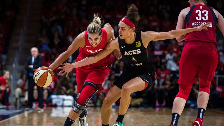 Elena Delle Donne drives by Dearica Hambry in the Mystics' playoff opener against the Las Vegas Aces