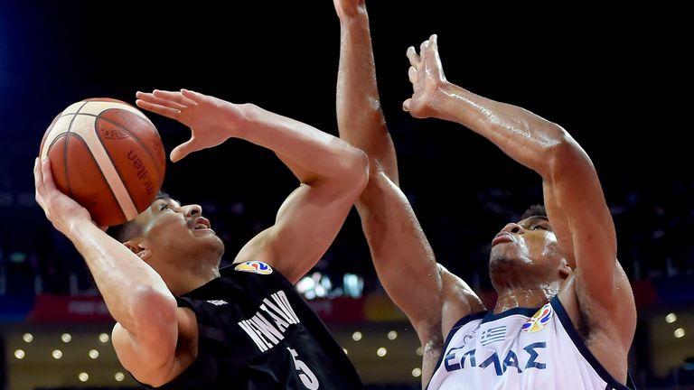 Giannis Antetokounmpo rises up to defend Shea Ili against New Zealand
