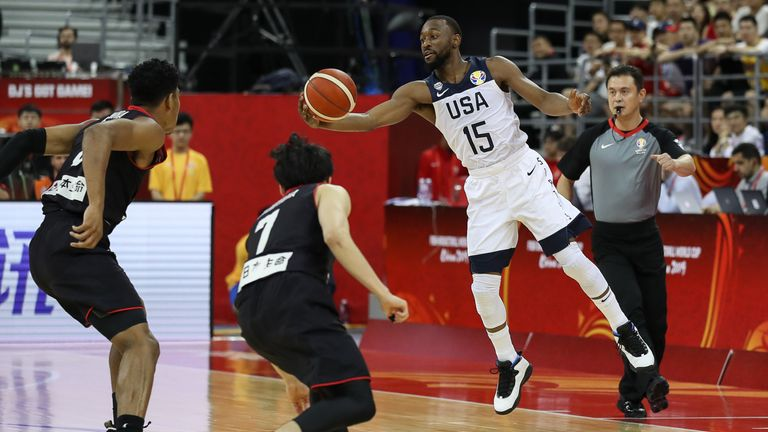 Kemba Walker stretches to catch the ball in mid-air against Japan