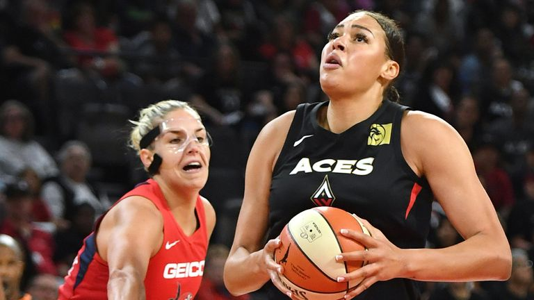 Liza Cambage drives by Elena Delle Donne to score in the Aces' Game 3 win