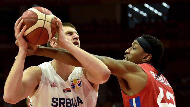 Nikola Jokic tries to evade close defensive attention against Puerto Rico