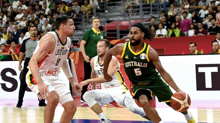 Patty Mills drives at pace for Australia against Lithuania