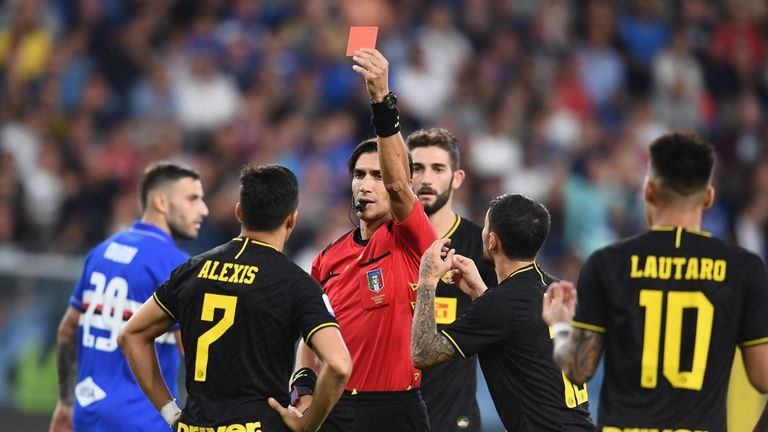 Alexis Sanchez is shown a red card during Inter's Serie A match against Sampdoria