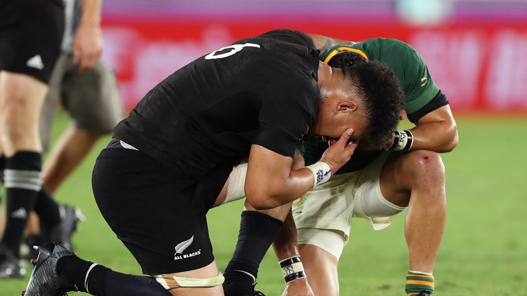Ardie Savea shares a prayer with Cheslin Kolbe after the match