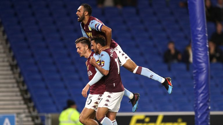 Aston Villa's Jack Grealish (left) celebrates scoring his side's third goal against Brighton