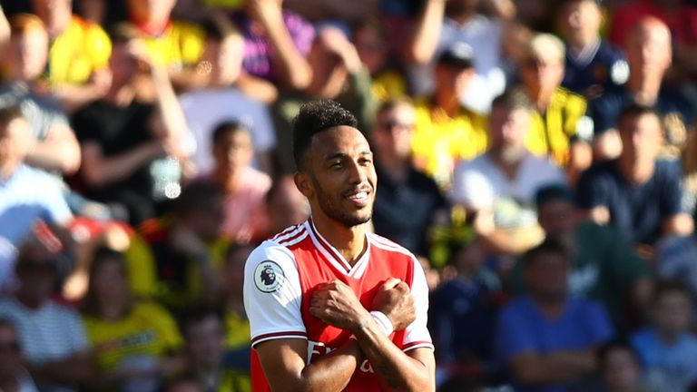 WATFORD, ENGLAND - SEPTEMBER 15: Pierre-Emerick Aubameyang of Arsenal celebrates as he scores his team's first goal during the Premier League match between Watford FC and Arsenal FC at Vicarage Road on September 15, 2019 in Watford, United Kingdom. (Photo by Julian Finney/Getty Images)