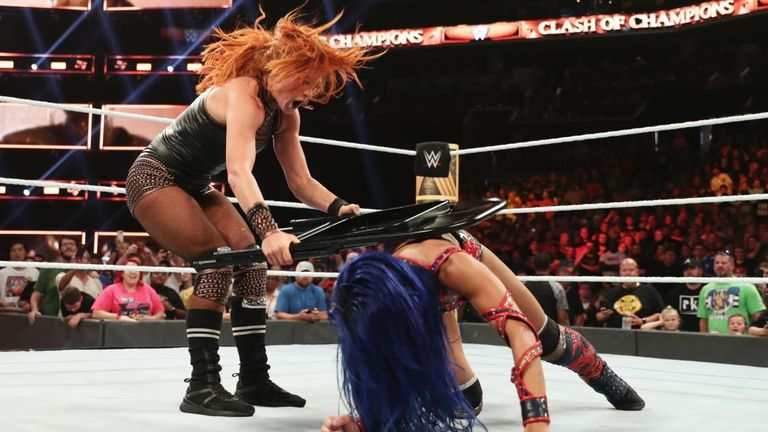 Becky Lynch blasts Sasha Banks with a steel chair in their brutal Raw women's championship match