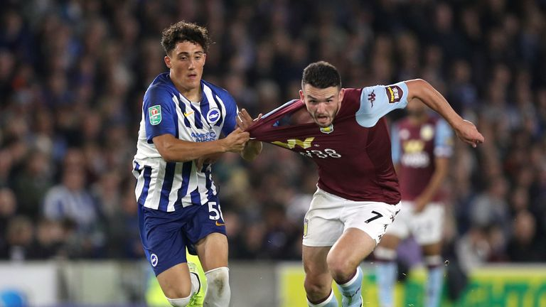 Brighton's Haydon Roberts and Aston Villa's John McGinn battle for the ball