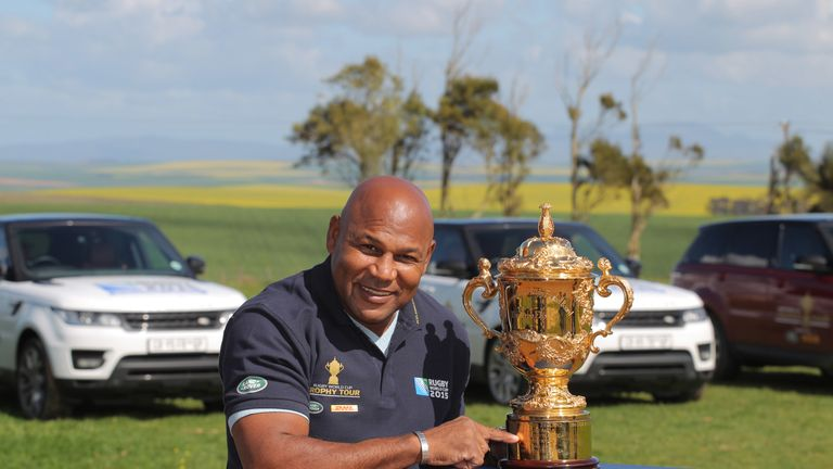 Williams poses with the Webb Ellis Cup trophy ahead of the 2015 World Cup