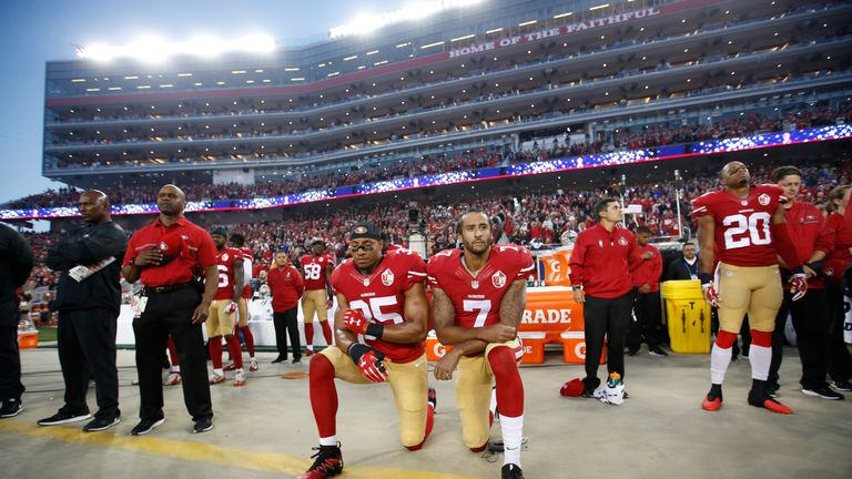 Eric Reid and Kaepernick kneeling during the anthem prior to a game against the Los Angeles Rams on September 12, 2016