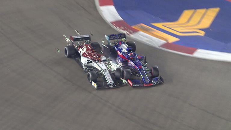 Alfa Romeo's Kimi Raikkonen crashes into Toro Rosso's Daniil Kvyat bringing an end to his Singapore GP.