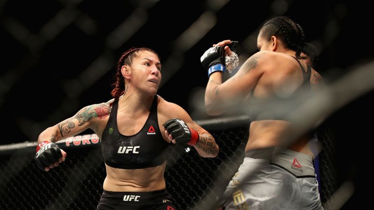 Cris Cyborg of Brazil (left) is punched by Amanda Nunes (right) during a Women's Feather weight bout during the UFC 232 event inside The Forum on December 29, 2018 in Inglewood, California.