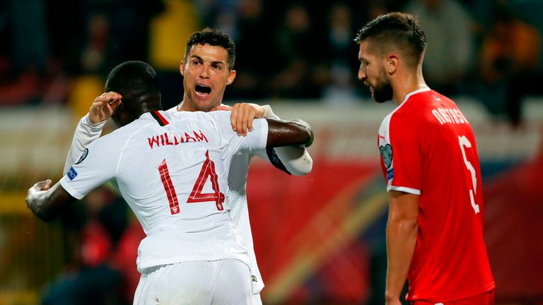 Portugal's Cristiano Ronaldo celebrates a goal with his team-mate William Carvalho