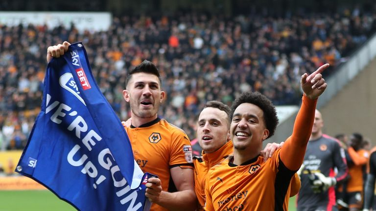 Danny Batth of Wolverhampton Wanderers celebrates promotion to the Premier League after the Sky Bet Championship match between Wolverhampton Wanderers and Birmingham City