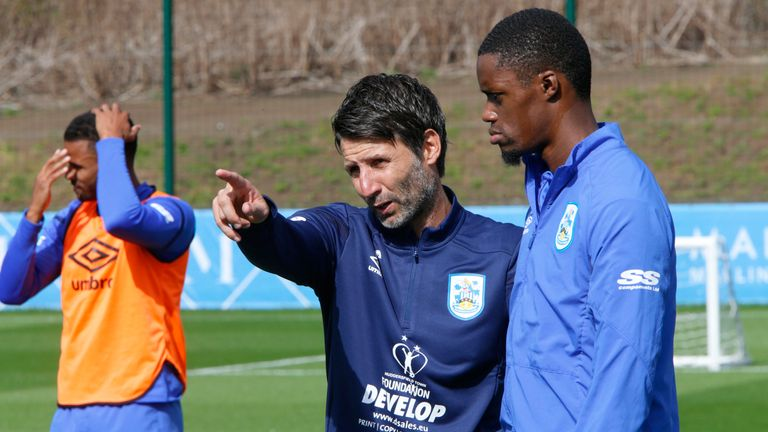 Danny Cowley speaks with Adama Diakhaby during his first training session as the new manager of Huddersfield Town