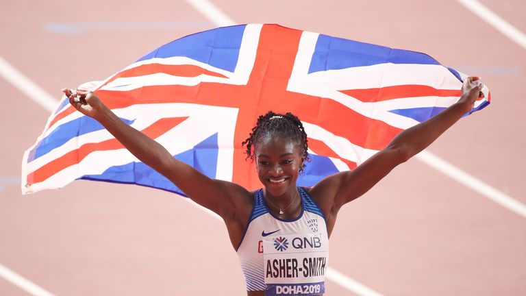 Dina Asher-Smith celebrates her World 200m title in Doha
