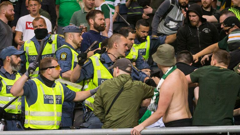 Supporters clash with police at AIK's stadium during the Europa League qualifier