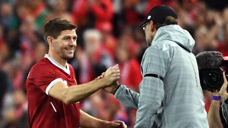 Liverpool player Steven Gerrard (2nd L) shakes hands with coach Jurgen Klopp after being substituted during their end-of-season friendly football match against Sydney FC at the Olympic Stadium in Sydney on May 24, 2017