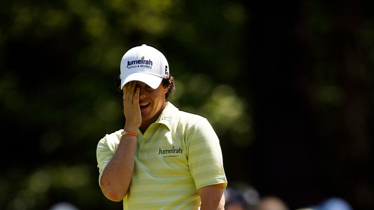 McIlroy reacts to a missed putt