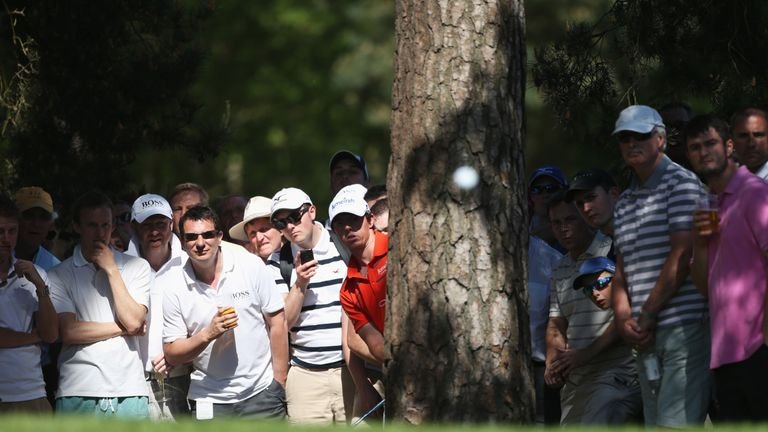 McIlroy hits from behind a tree to the 10th green during his second round