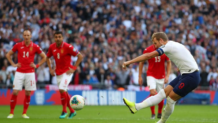 Harry Kane scores from the penalty spot to complete his hat-trick against Bulgaria