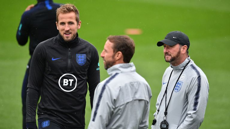 Harry Kane speaks with England manager Gareth Southgate and assistant Steve Holland during a training session in Southampton