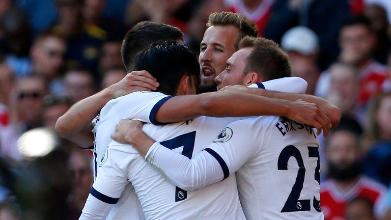 Tottenham celebrate a goal against Arsenal