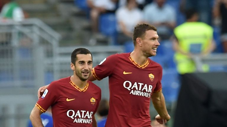 Mkhitaryan and Dzeko during the Serie A match between AS Roma and US Sassuolo at Stadio Olimpico on September 15, 2019 in Rome, Italy.
