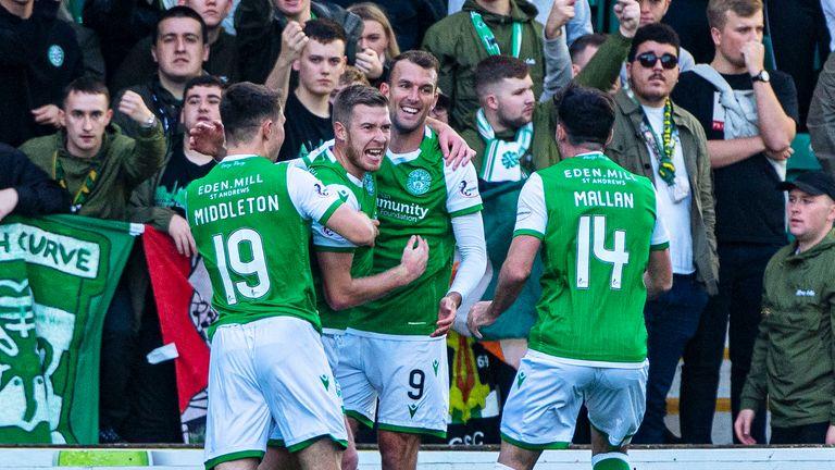 Christian Doidge (centre) celebrates the own goal that put Hibernian ahead against Celtic.