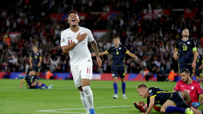 Jadon Sancho celebrates his first international goal for England