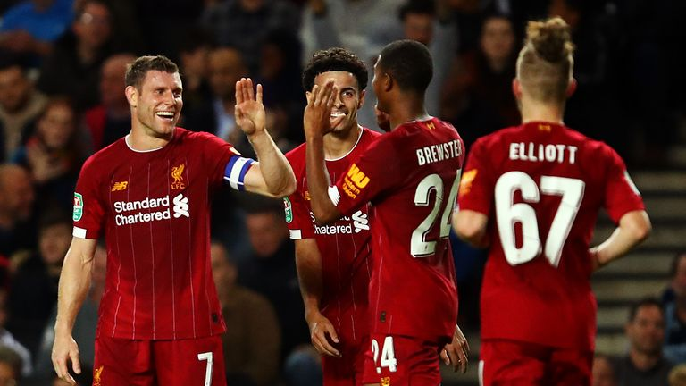 James Milner celebrates his opening strike against MK Dons on Wednesday