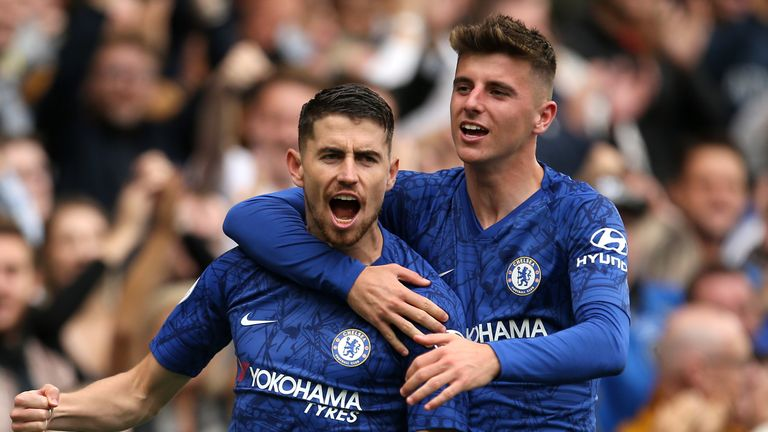 Jorginho celebrates with Mason Mount after converting his penalty