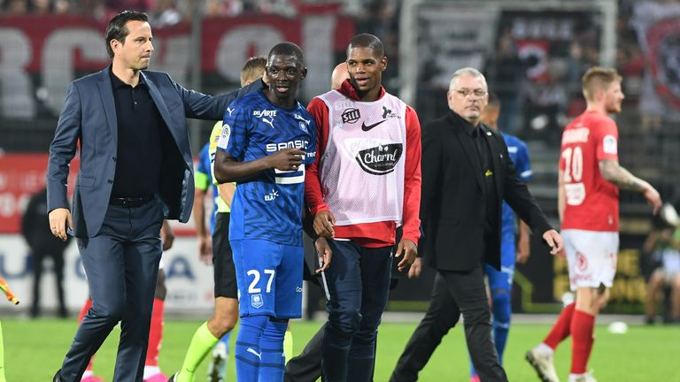 Julien Stephan congratulates his players after drawing with Brest at the weekend