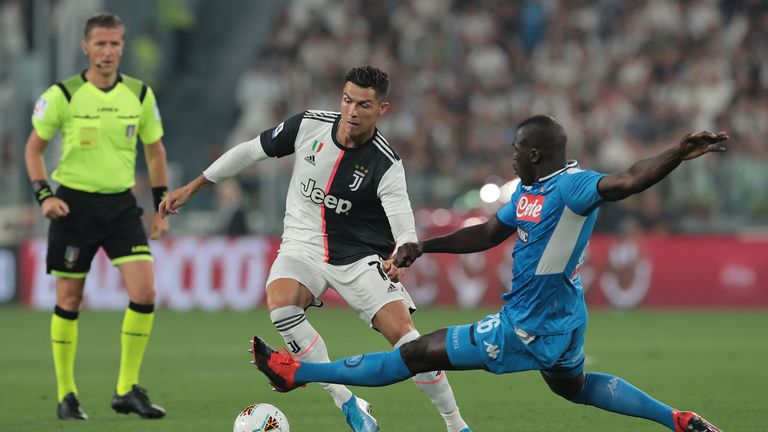 Juventus' Cristiano Ronaldo and Napoli's Kalidou Koulibaly battle for the ball during the 4-3 defeat for Ancelotti's side at the Allianz Stadium