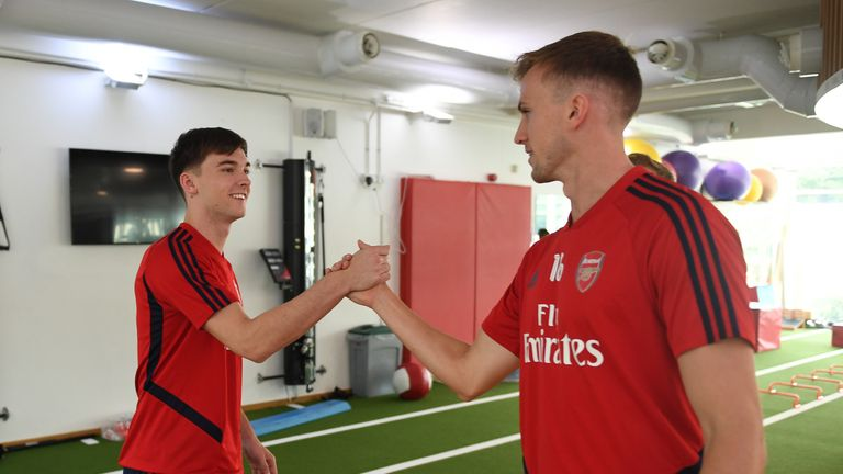 Arsenal new boy Kieran Tierney is greeted by Rob Holding