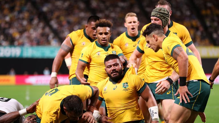 Tolu Latu touched down for two maul tries as the Wallabies hit the front for the first time on 62 minutes
