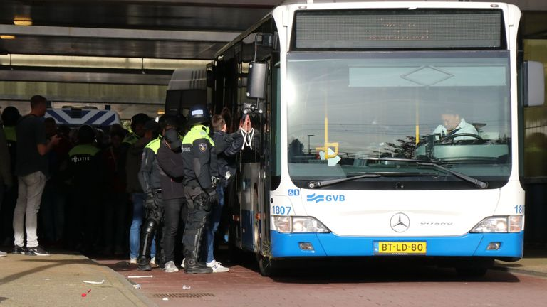 A Lille supporter is arrested by the police in Amsterdam