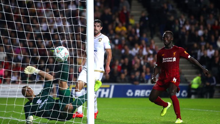 A goalkeeping howler from MK Dons 'keeper Stuart Moore saw Liverpool take the lead through James Milner
