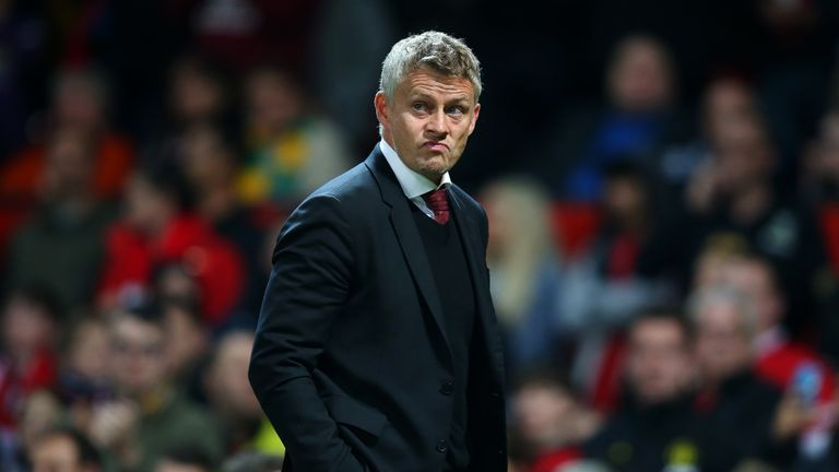Manchester United Manager, Ole Gunnar Solskjaer walks off at half time during the Carabao Cup Third Round match between Manchester United and Rochdale AFC at Old Trafford