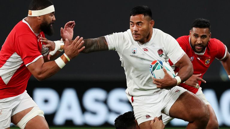 Manu Tuilagi ran in two tries to help England open their World Cup campaign with a win