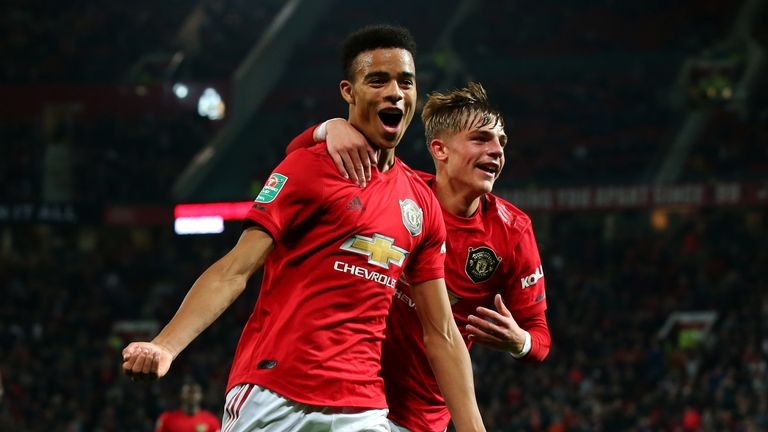 Mason Greenwood of Manchester United celebrates scoring his teams first goal of the game with team mate Brandon Williams during the Carabao Cup Third Round match between Manchester United and Rochdale AFC at Old Trafford