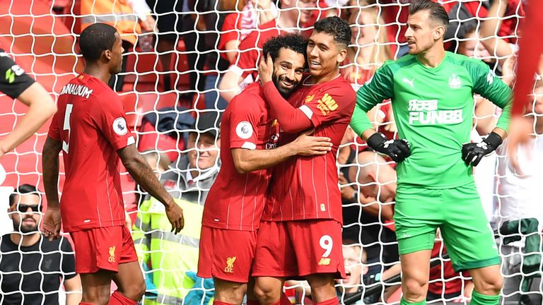 Mohamed Salah celebrates with Roberto Firmino after making it 3-1 to Liverpool