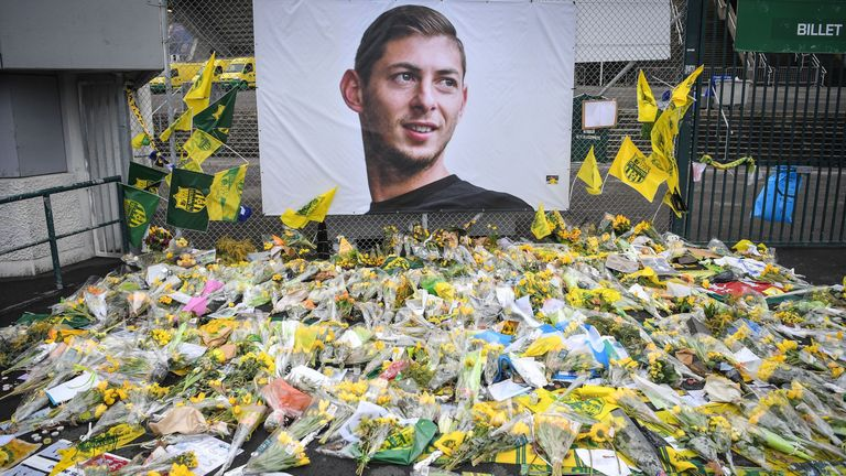 Yellow flowers are displayed in front of the portrait of Argentinian forward Emiliano Sala at the Beaujoire stadium in Nantes